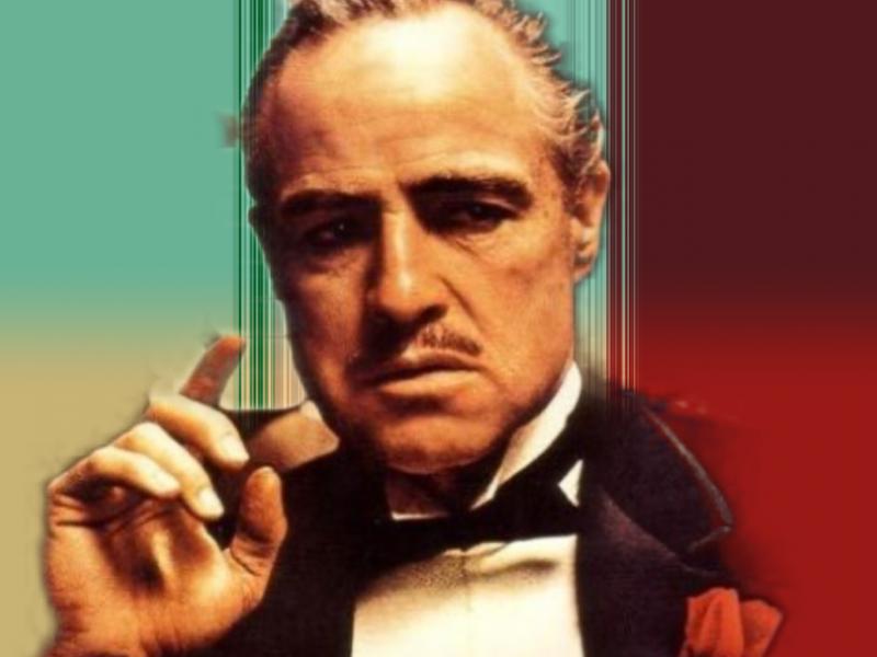 """Don Vitto Corleone, kadr z filmu """"Ojciec Chrzestny"""". Opracowanie: EURACTIV.pl"""